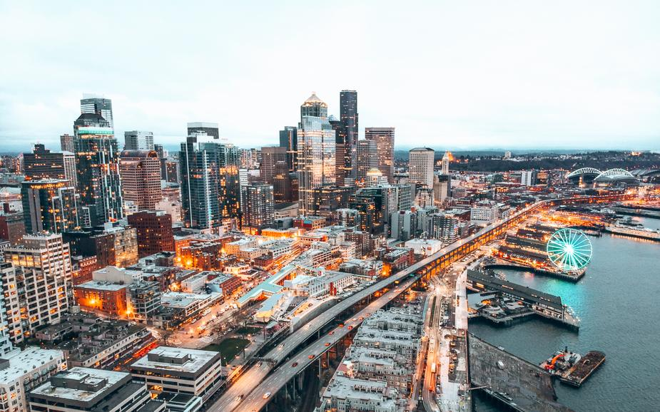 a-city-skyline-illuminated-as-the-sun-starts-to-set.jpg